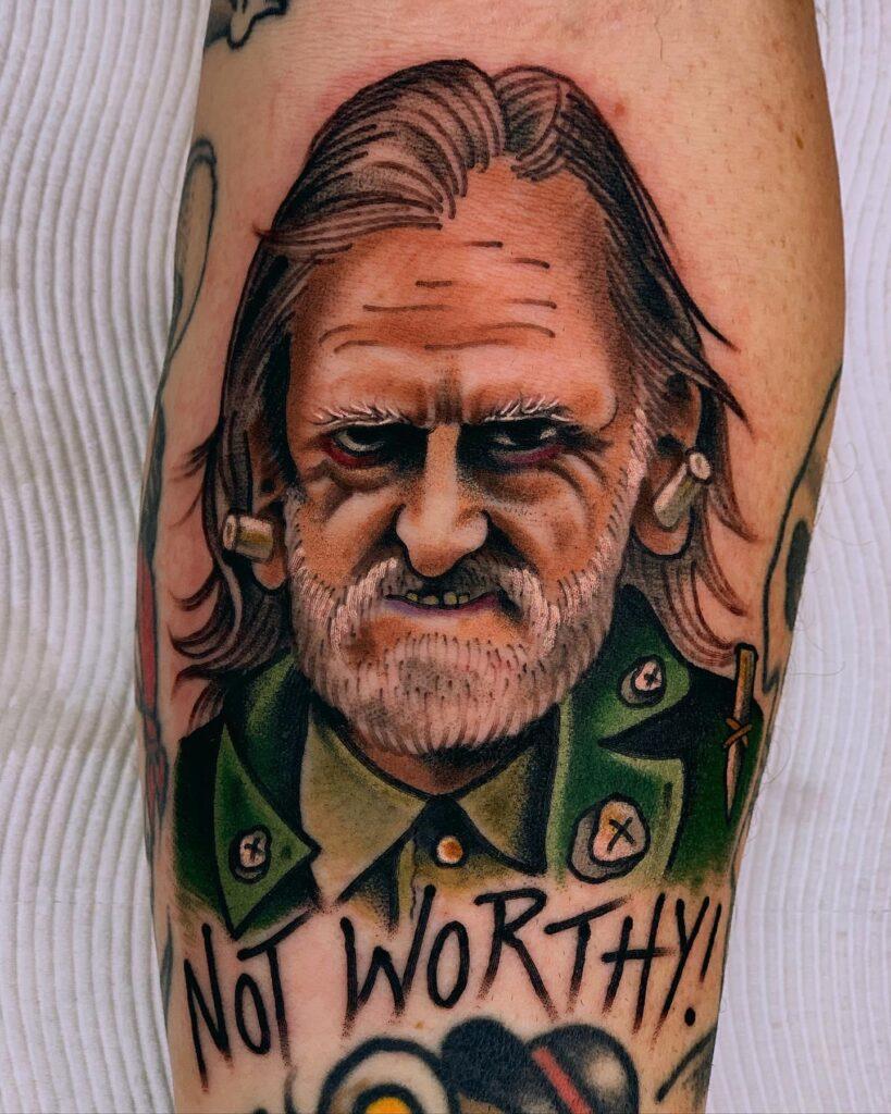 Button Man Tattoo